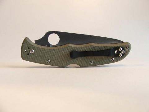 черная клипса на зеленой рукоятке