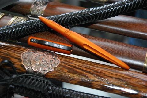 оранжевая тактическая ручка